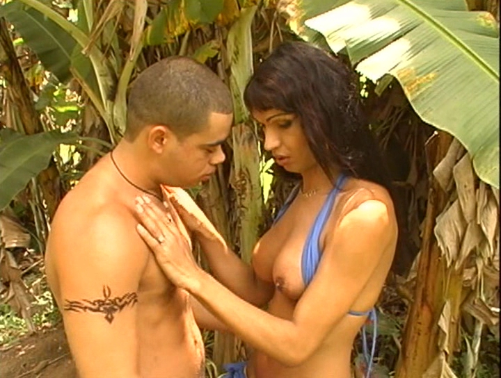 Lovely brunette shemale naked with her hunky fella outdoors