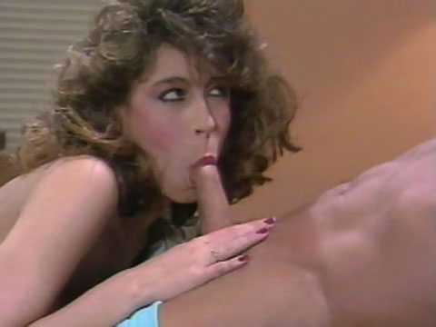 Christy Canyon sucking on a large cock